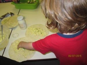 Spreading the tasty mixture onto the wraps